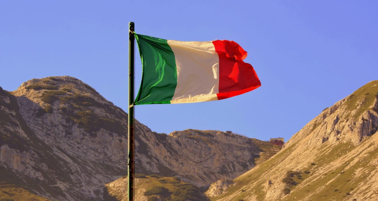 Italy flag with mountains as a backdrop